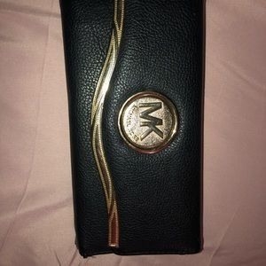 Damaged MK wallet